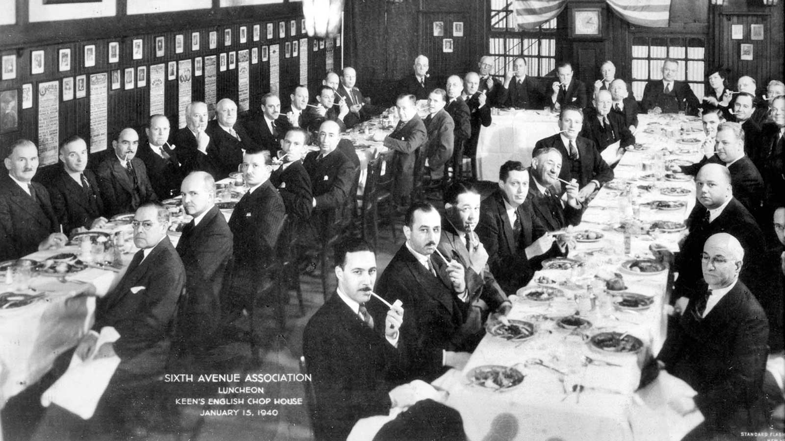 Well-dressed Keens patrons chewing on their churchwardens at a 1940 gathering.