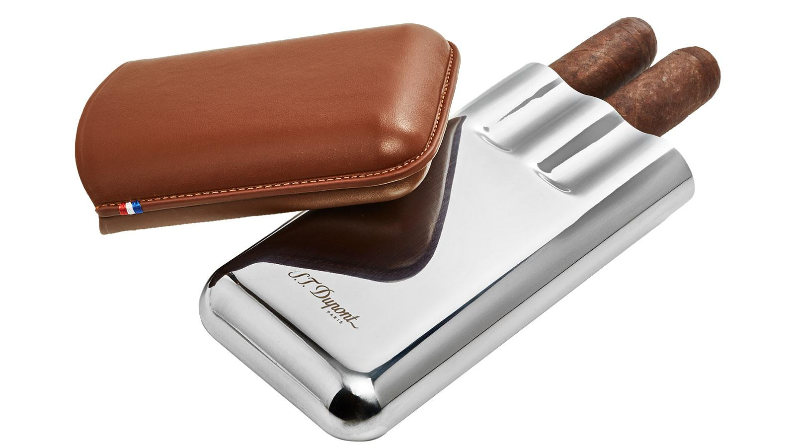 Visually striking and durable, S.T. Dupont's Triple Cigar Case is made from rich brown calfskin and metal.