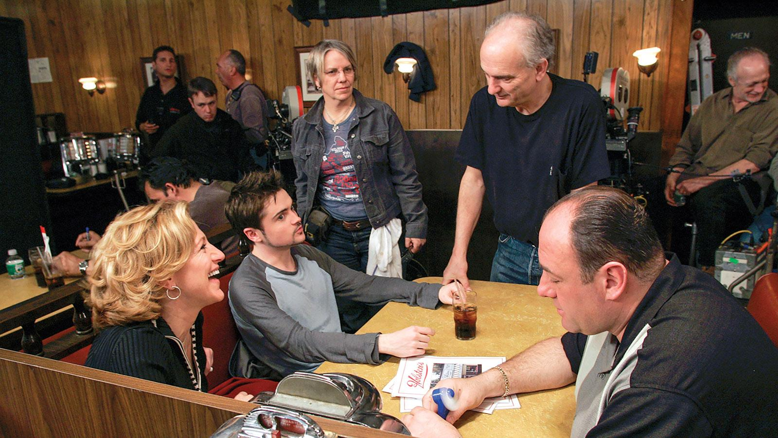 David Chase (standing, in black shirt) directing Edie Falco, Robert Iler and Gandolfini in the controversial final episode that aired on June 10, 2007.