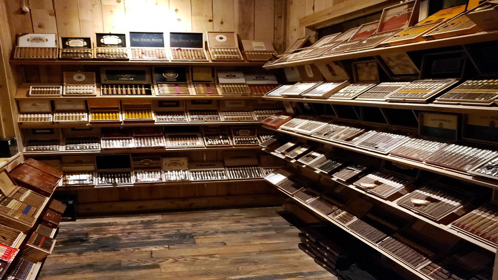 The humidor is well-stocked with more than 100 different cigars.
