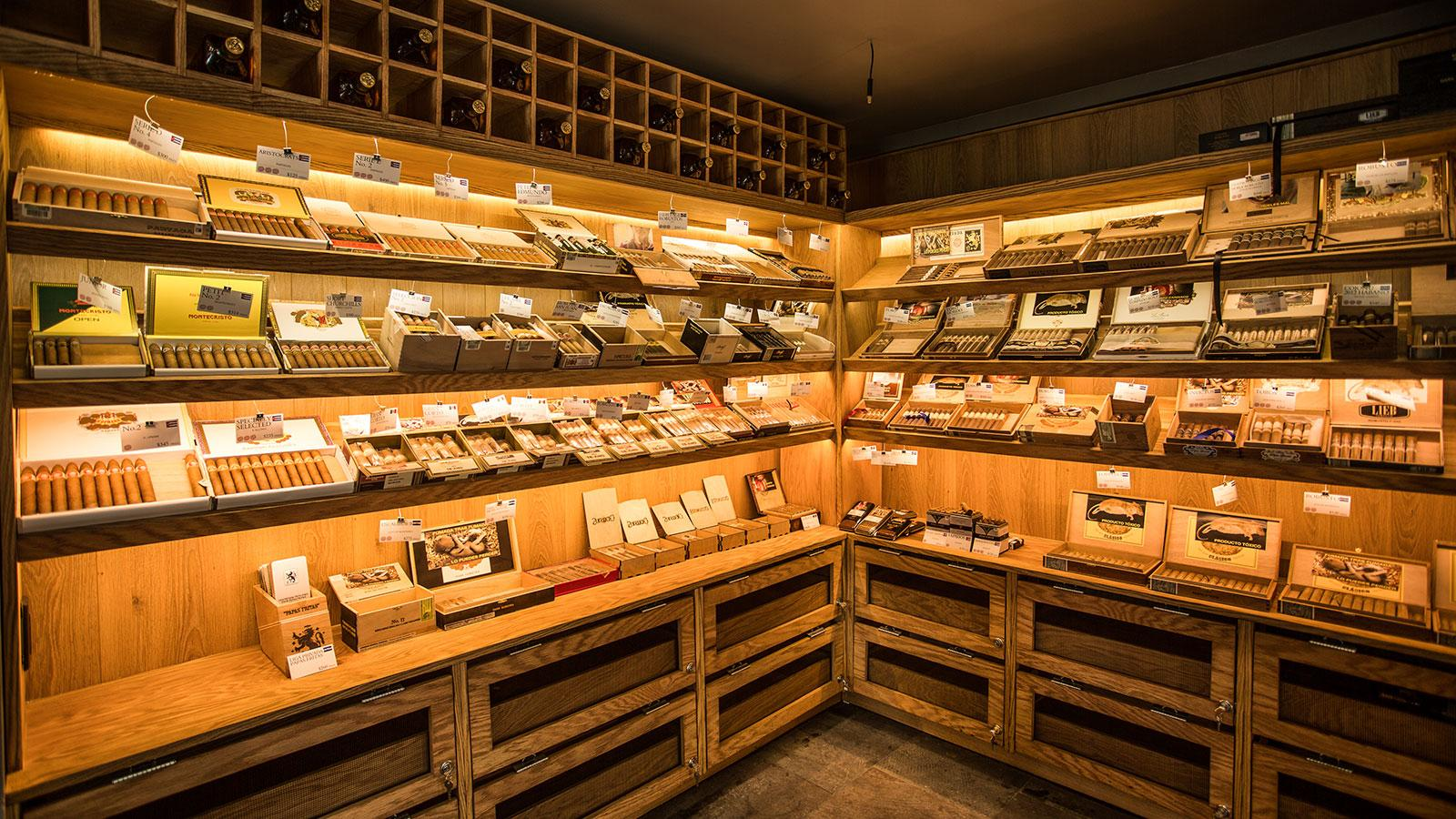 The walk-in humidor is stocked with a variety of Cuban and non-Cuban cigars.