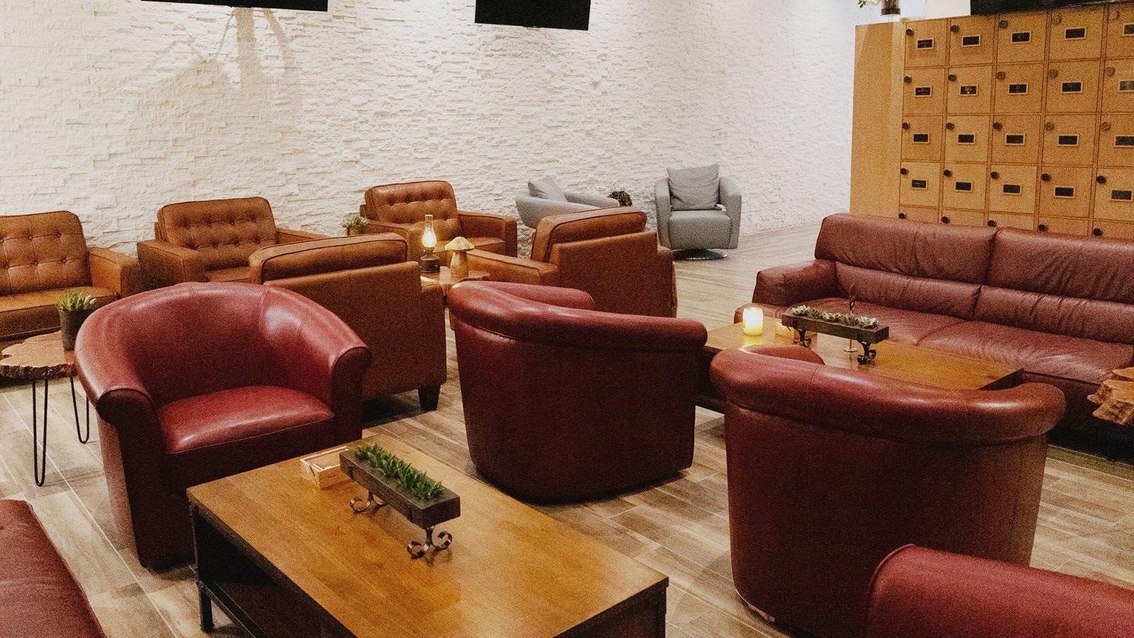 The private area has seven TVs, member lockers and seating in red leather chairs and sofas for about 45.