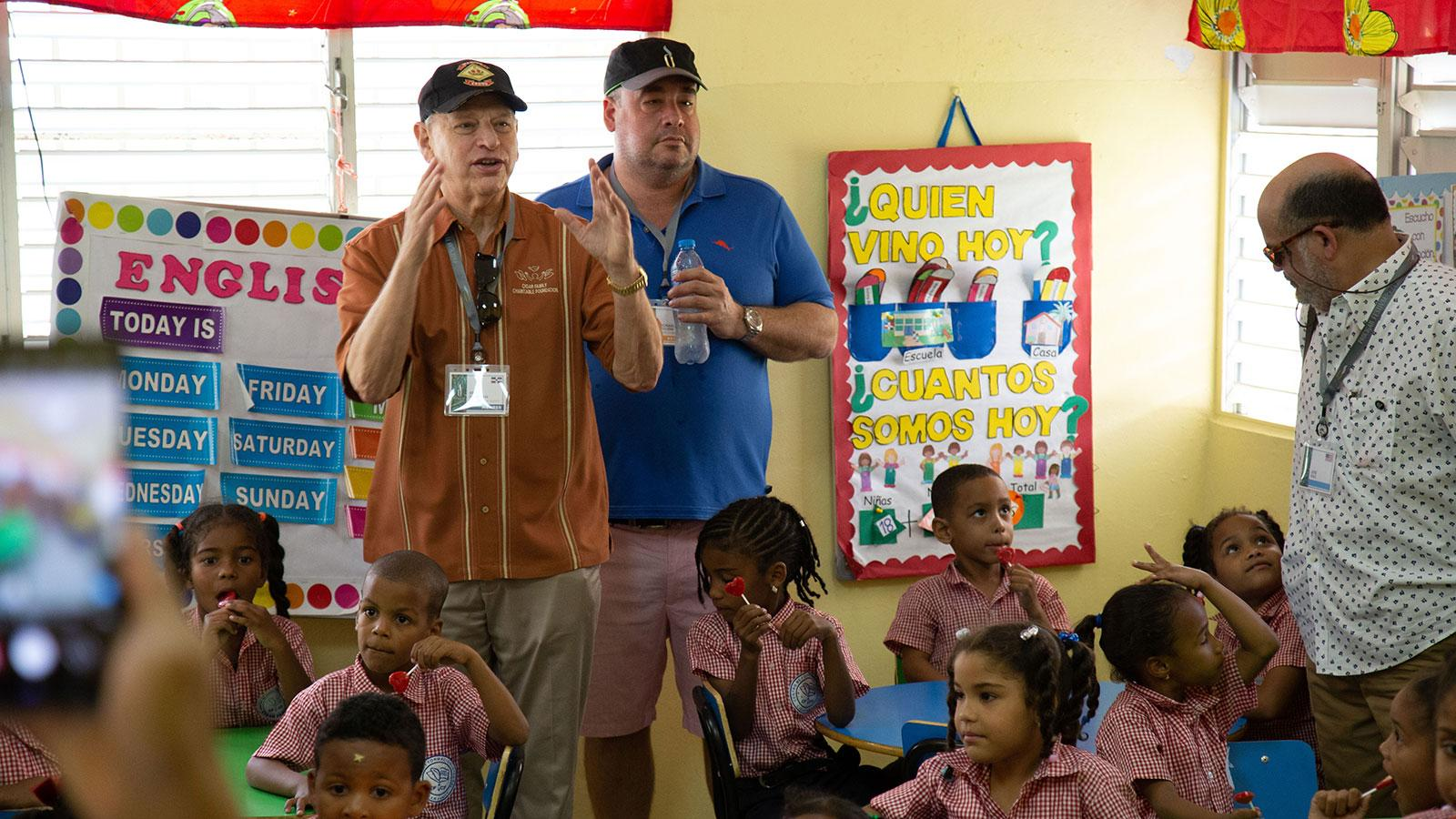 "Eric Newman of J.C. Newman Cigars leading a tour of the Cigar Family School. Started in 2001, the Cigar Family Charitable Foundation has raised millions of dollars for the impoverished children of the Dominican Republic, including building a school. ""The only way to break the cycle of poverty is through education,"" says Newman."