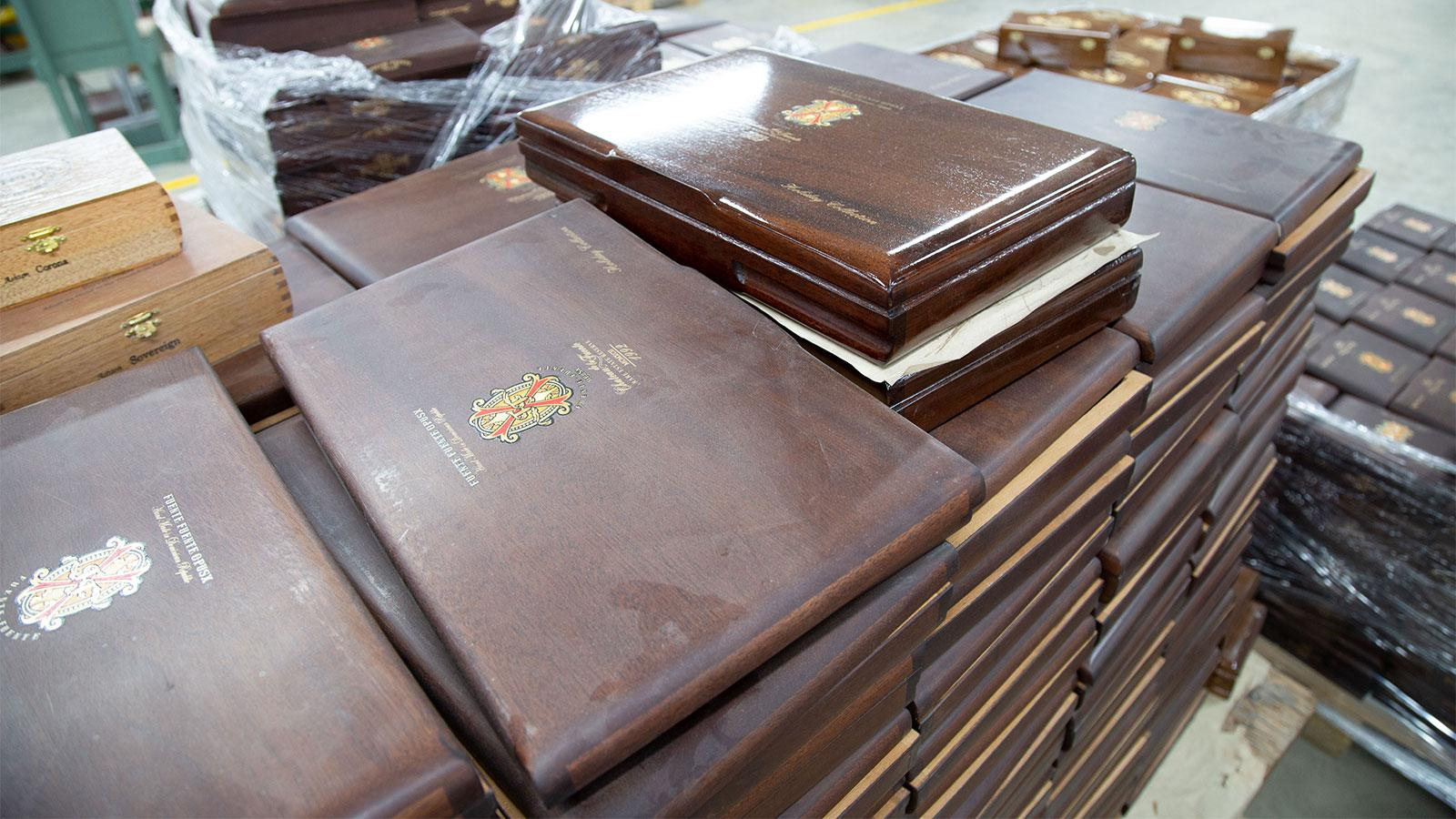 A stack of Fuente Fuente OpusX boxes that will soon be lacquered like the shiny one on top.