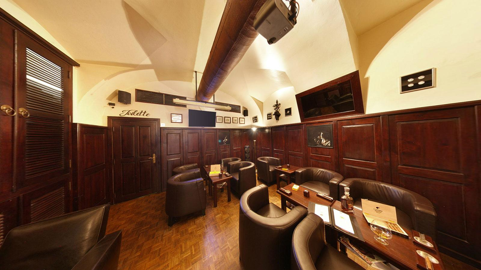 Walk past the counter and humidor into the lounge where there is a TV and 20 or so overstuffed leather chairs.