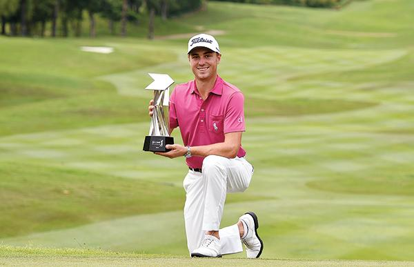 Thomas holding the CIMB Classic trophy in Malaysia in October. He won the same tournament in 2015.