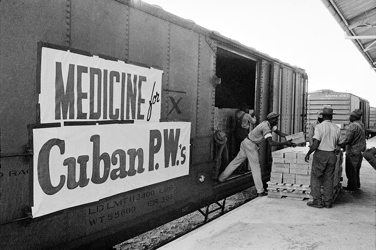 December 20, 1962. Longshoremen in Florida unload food and medicine bound for Cuba, part of the $53 million worth of U.S. goods sent for the release of the prisoners of war.