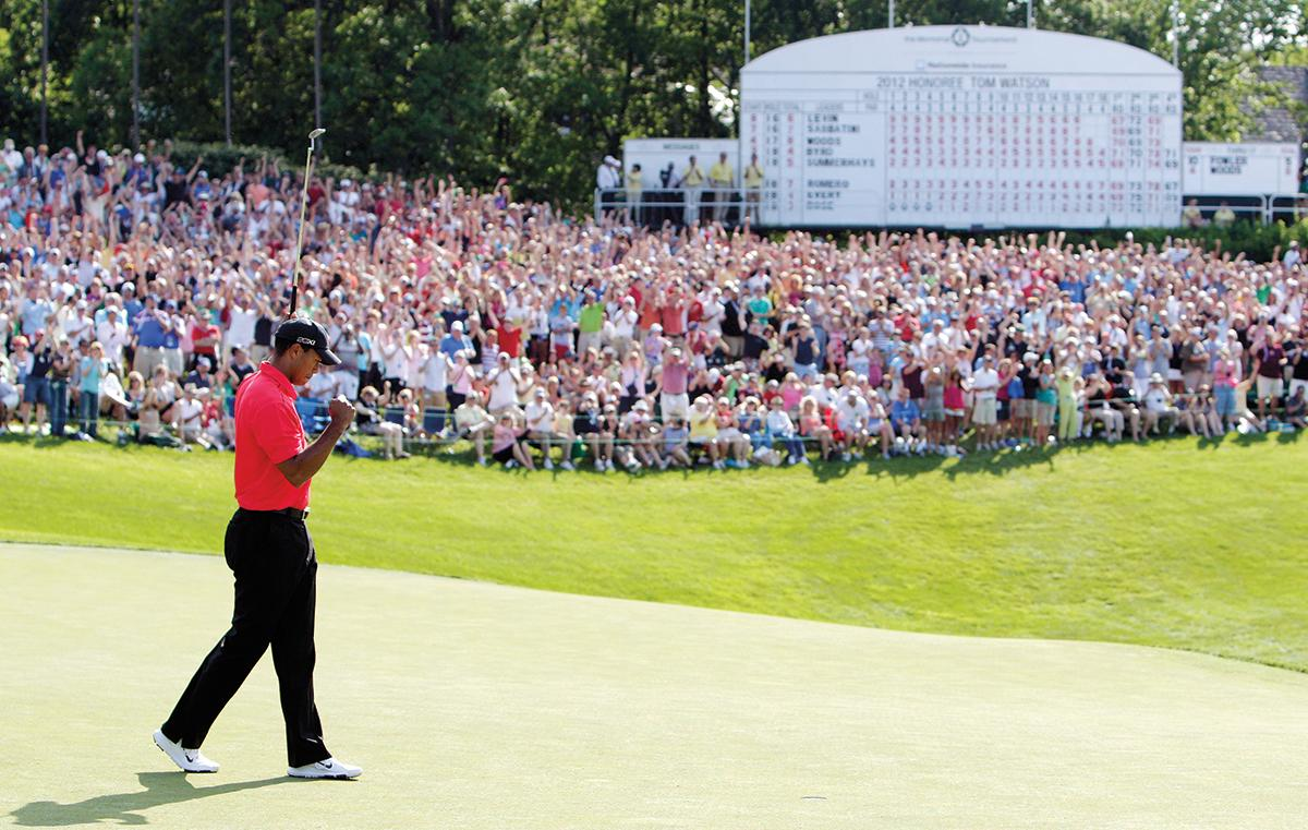 Woods pumps his fist after making a birdie to close the 2012 Memorial Tournament, when he tied host Jack Nicklaus with his 73rd PGA Tour win.