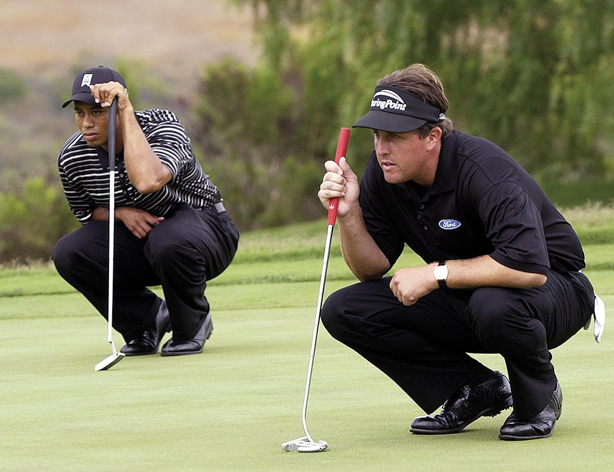 Rivals Woods and Phil Mickelson square off at the Battle At The Bridges in 2003. Mickelson would have ranked No. 1 in the world without Woods.