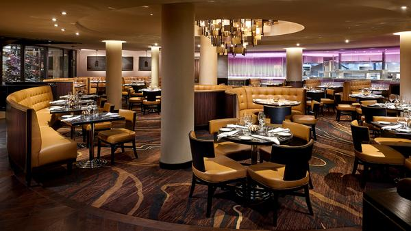 You can smell the rich aroma of steaks searing on wood fire while being shown to your table inside the two-level restaurant.