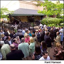 Guests crowd the patio at the Tra Vigne restaurant in Napa on Wednesday night.