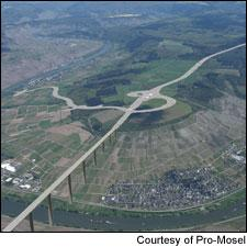 This digitally altered image shows what a proposed bridge and highway in the Mosel could look like.