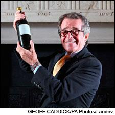 French collector Christian Vanneque hoists his bottle of 1811 Yquem. His financial advisor had no comment on Vanneque's plans to drink it.