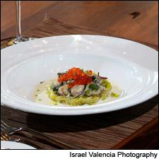 Beads of salmon caviar give a saline pop to this rich and creamy oyster dish.