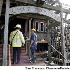 Firefighters assess the damage to the first-floor dining alcove of Chez Panisse after a fire on March 8.
