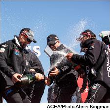 Oracle Team USA celebrates not falling out of the boat by drenching each other in Mumm Napa Brut Prestige.