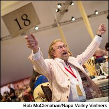 Robert Van Dyk celebrates his winning bid at the 2014 Auction Napa Valley