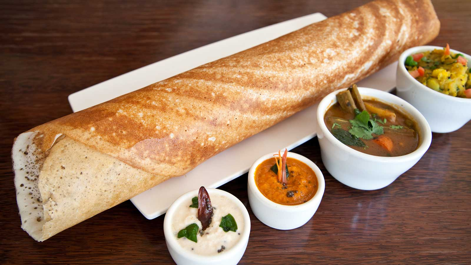 Varying levels of heat for this dosa can challenge wine, but a soft blend of Riesling and Sauvignon Blanc works well.