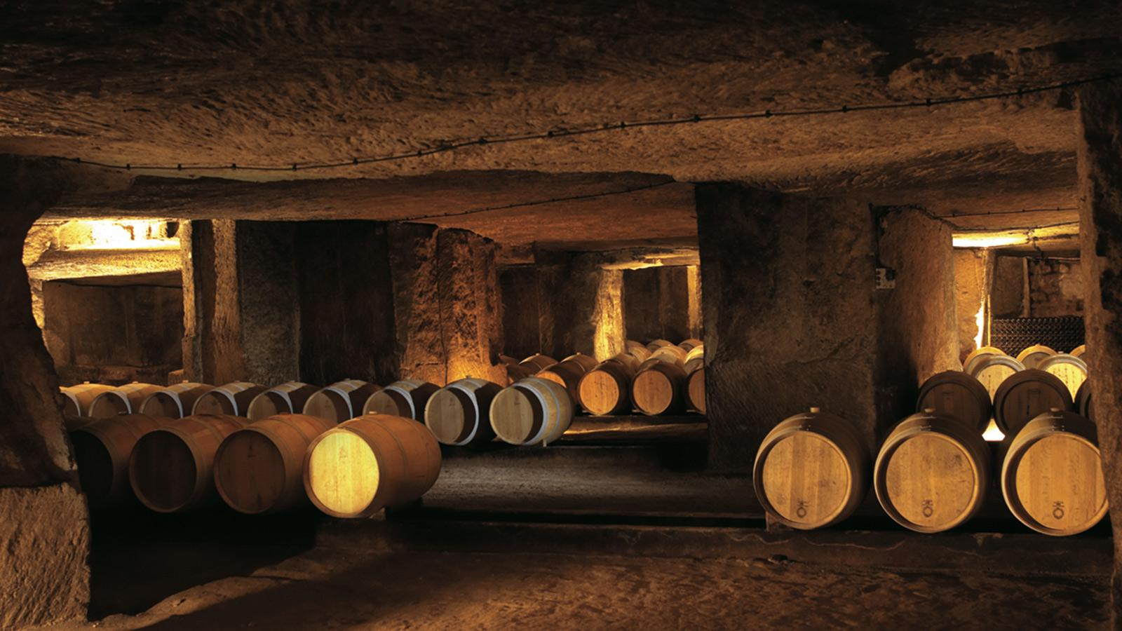 Clos Fourtet's aging wines rest in barrel in the estate's 30 acres of hand-hewn limestone caves.