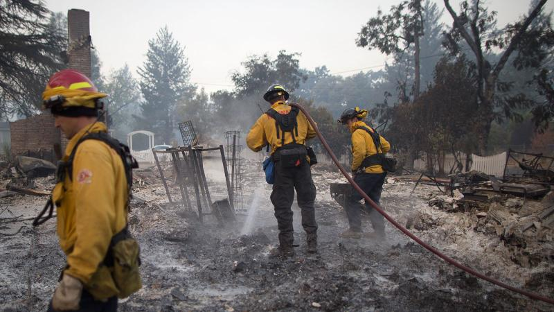 Firefighters put out a fire that destroyed a home in Middletown, Calif.