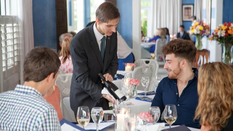 Sommelier Clement Cariot helps guests navigate the embarrassment of French riches in the cellar at new Grand Award winner Bleu Provence in Naples, Fla.