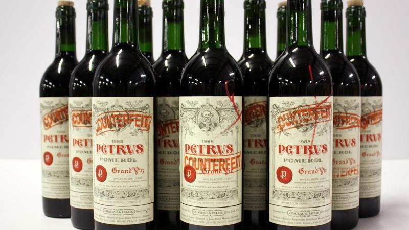 These bottles of Pétrus from Kurniawan's cellars were marked counterfeit and will be destroyed.