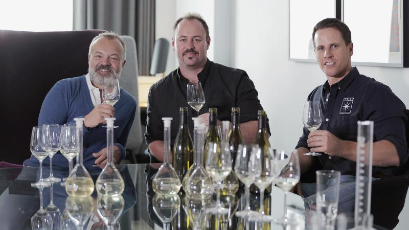Graham Norton (left) authenticates the blend for Graham Norton's Own Sauvignon Blanc with actual Invivo winemaker Rob Cameron (center) and cofounder Tim Lightbourne.