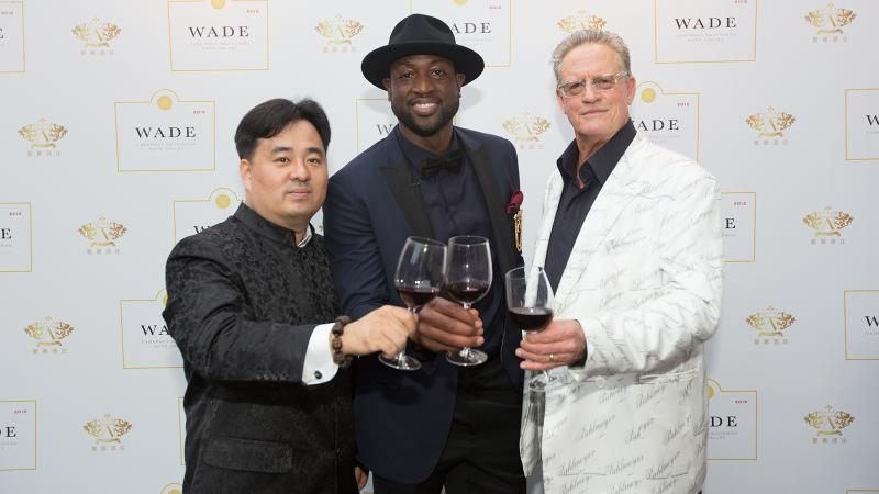 Nee Lau (left) cheers Dwyane Wade and Jayson Pahlmeyer (right) in Beijing.