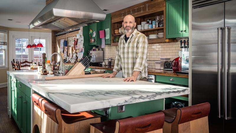 Marc Vetri customized his kitchen with an 11-foot-long, marble-topped island to maximize the narrow space.