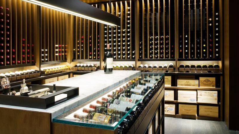 Architect Soo Chan collected bottles of La Tâche throughout his career before building a cellar that combines different textures with floor-to-ceiling windows and hand-hammered granite.