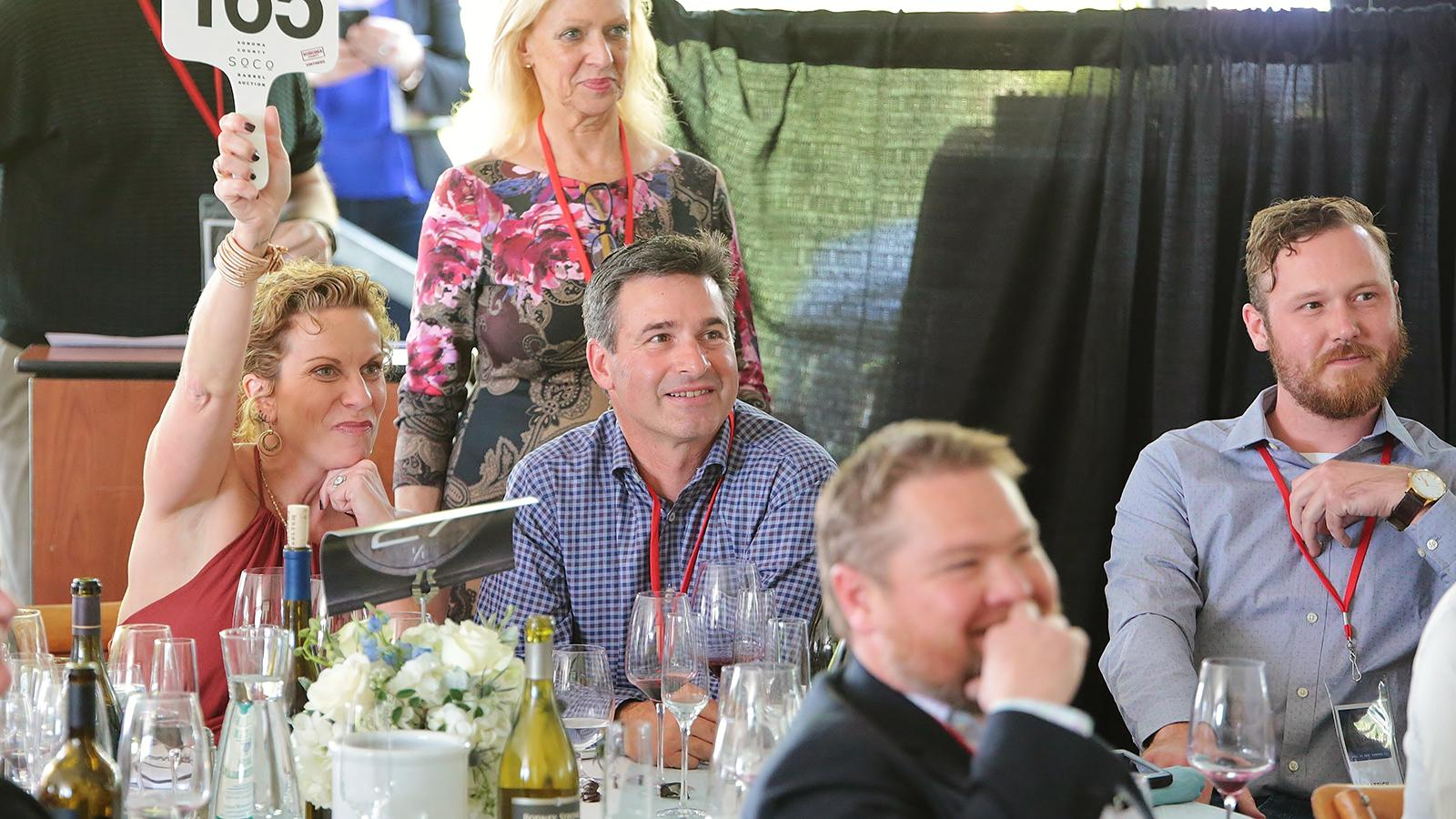 Wendy Heilmann, director of wine and spirits for Pebble Beach Resorts, bids on a lot at the Sonoma Barrel Auction.