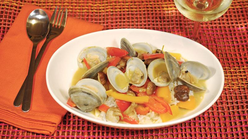 Red and yellow bell peppers add a burst of color to this flavorful take on steamed clams.