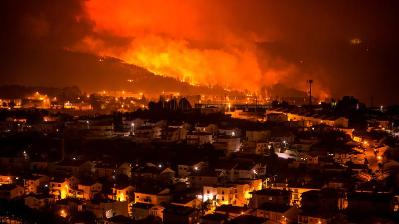 Flames burn hillside forests near the Portuguese town of Braga.