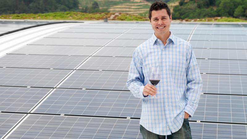 Odette winemaker Jeff Owens stands atop his winery, with enough solar panels to power the facility year-round.