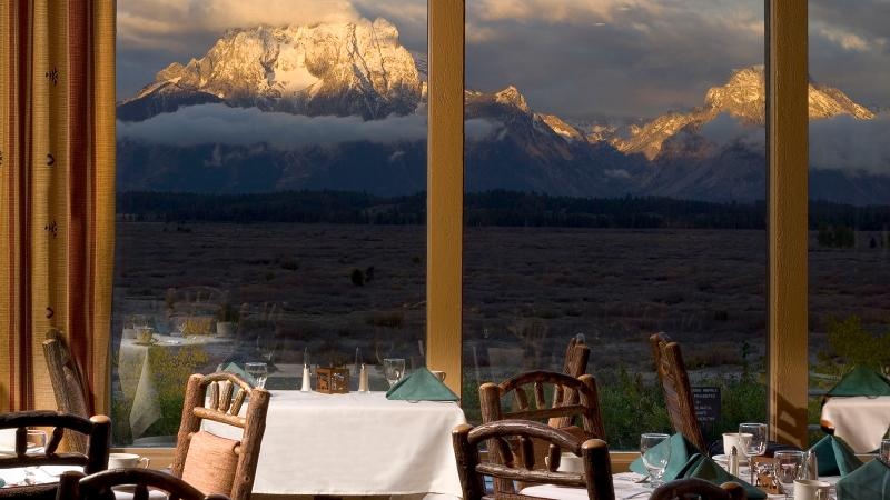 At the Mural Room restaurant, towering floor-to-ceiling windows frame views of the Tetons.