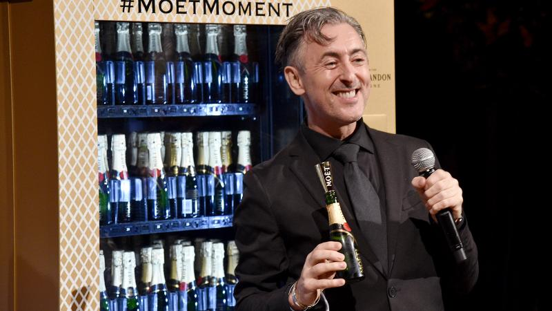 Actor Alan Cumming took bids for the coveted Moët & Chandon vending machine.