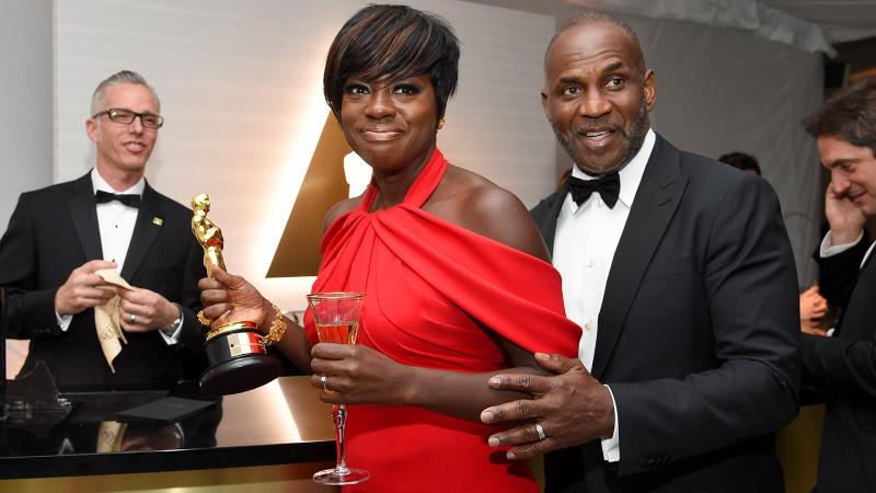 Viola Davis pairs her Piper-Heidsieck with her Best Supporting Actress Oscar and husband, Julius Harris, at the Governors Ball.