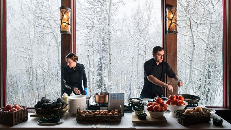 """Chef Maycoll Calderón and an assistant prepare the """"First Tracks & Gourmet Breakfast"""" meal for the 2017 Winter Culinary Weekend in Beaver Creek, Colo."""