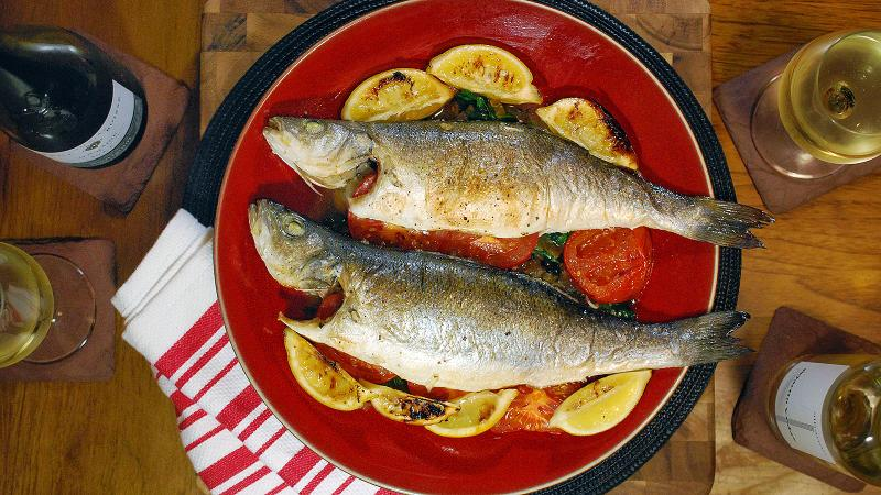 Look for a white wine with lively acidity to balance the tomatoes and lemons in this dish.