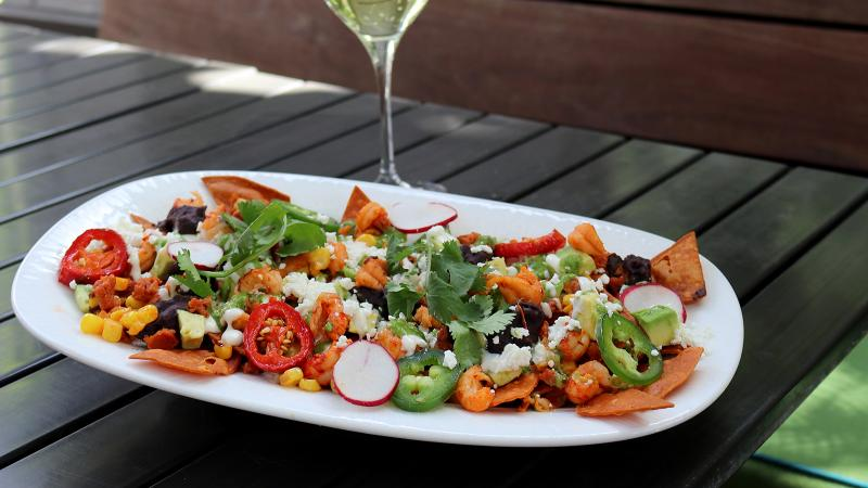 Embrace the heat of these Cajun-Tex-Mex nachos with an off-dry Riesling.