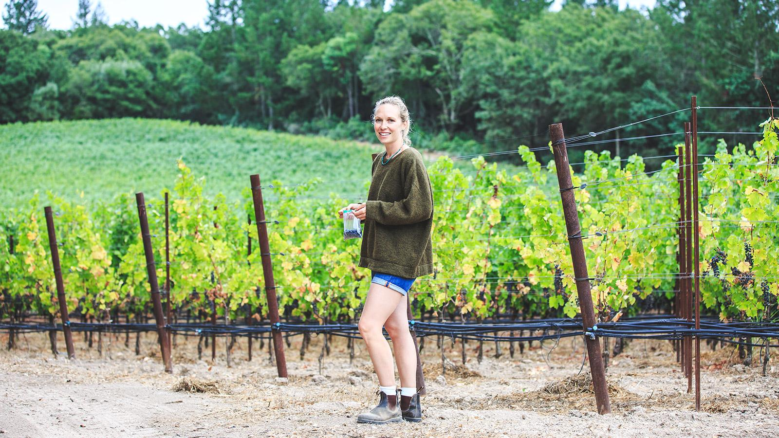 Diana Snowden Seysses checks up on the Cabernet vines at Brothers Vineyard.