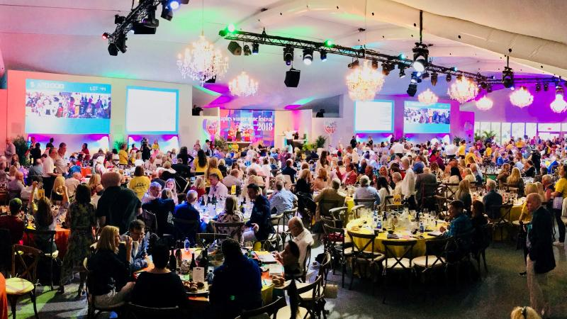 Bidders packed the tent at the Ritz-Carlton Golf Resort in Naples for this year's event.