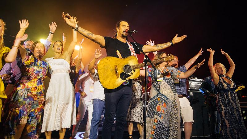 Napa vintners (including Danica Patrick, in white dress) joined singer Michael Franti on stage for a post-auction performance.