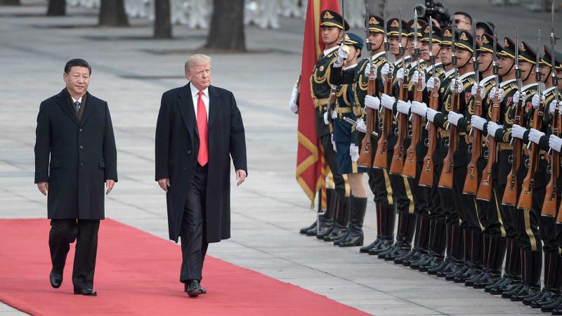 Chinese President Xi Jinping and U.S. President Donald Trump meet in Beijing.