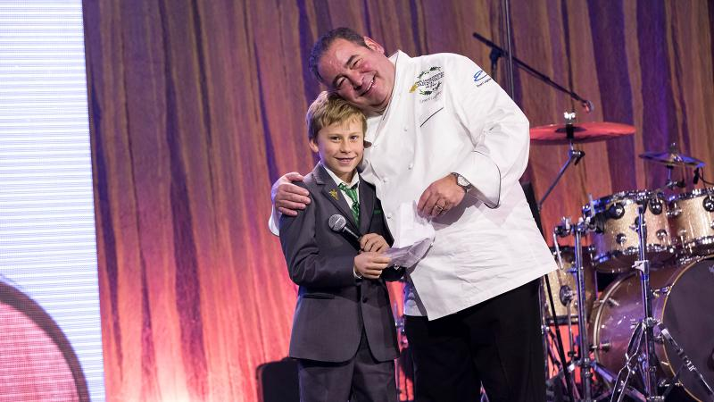 Cruz Bilbro joined Emeril Lagasse on stage at Carnivale du Vin for a special auction lot.
