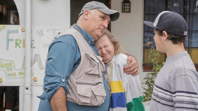 Chef José Andrés comforts a wildfire victim in Northern California.