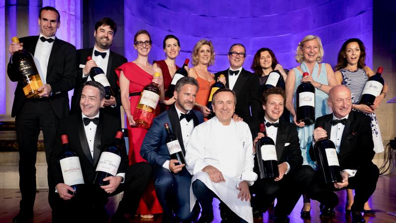 Chef Daniel Boulud (center), vintners and other honored guests showed off big bottles of Bordeaux at the 2018 Heart's Delight auction weekend.