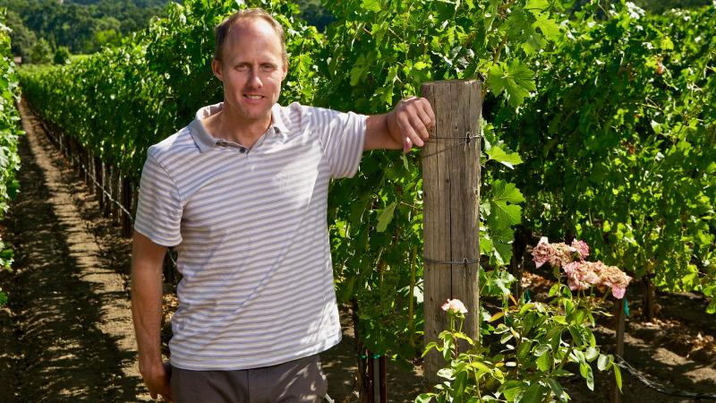 Winemaker Thomas Rivers Brown, here at another client's vineyard, will remain at Outpost for at least three years.