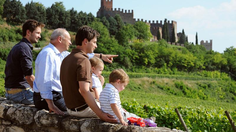 Leonildo Pieropan (pointing), with his sons Dario (left) and Andrea and two grandsons, in the vineyards of Soave. He believed in Soave's proud history and future potential.