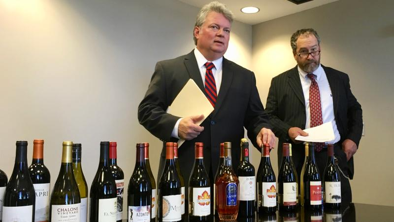 Mississippi Attorney General Jim Hood (left) and Revenue Commissioner Herb Frierson hold a press conference announcing a lawsuit against out-of-state wine retailers.